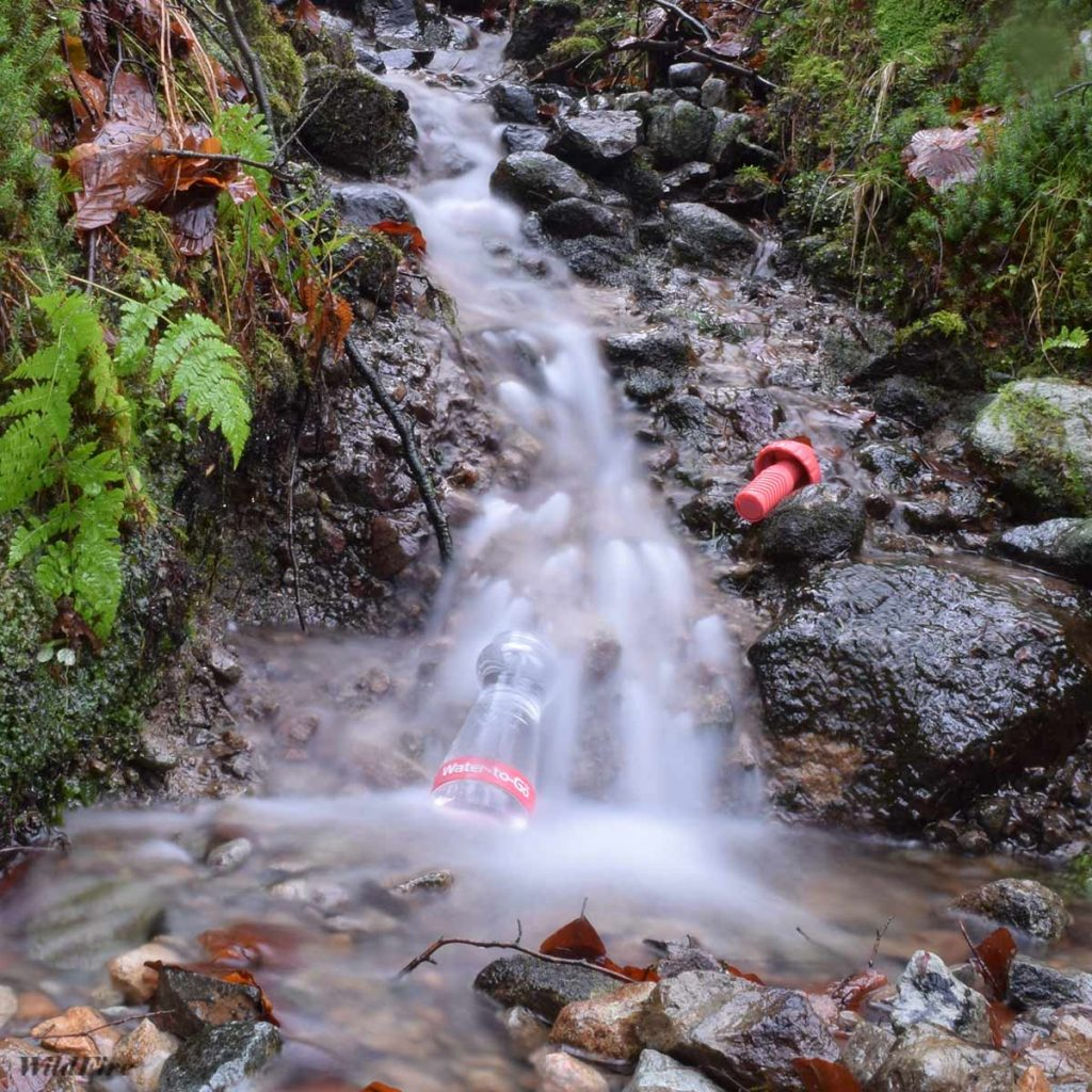 Filtering water from a stream on Raven Crag