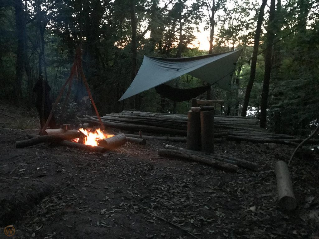 Hammock camping by the camp fire