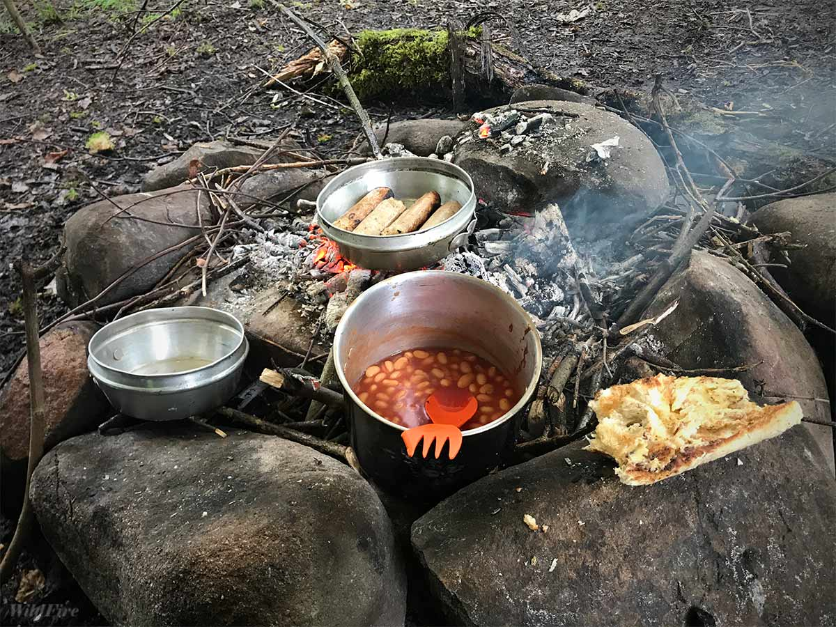 Full English breakfast cooking on the camp fire in the Forest of Bowland