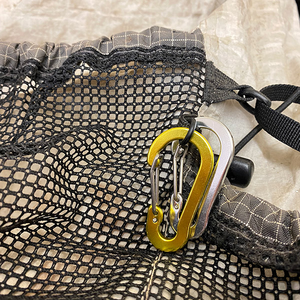 Carabiners hooked onto your rucksack